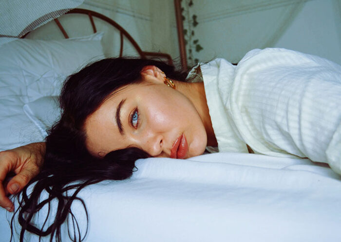 blue eyes woman in bed