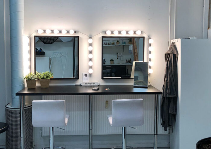 makeup room with vanity lights