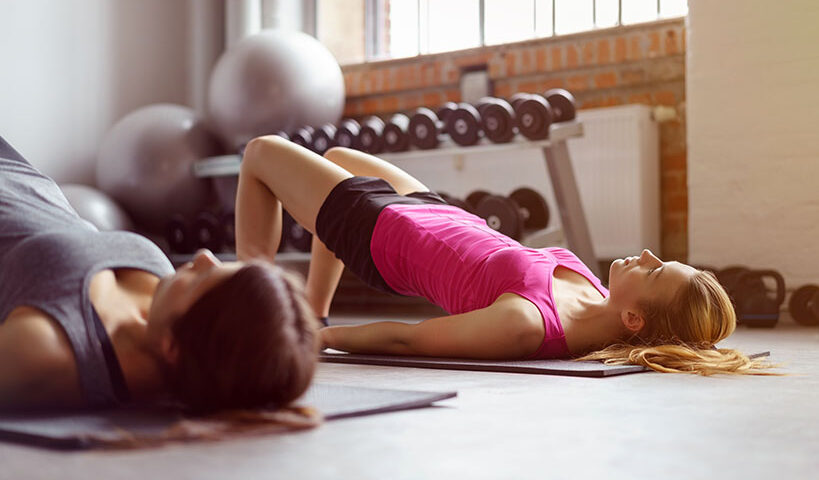 two women doing exercises at the gym