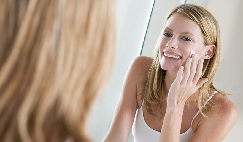 woman applying stemuderm anti-aging cream