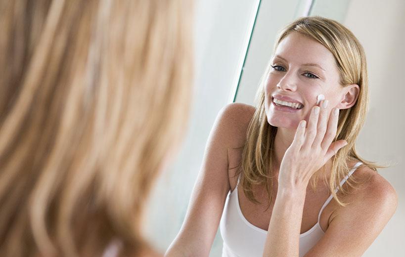 woman applying stemuderm anti-aging cream